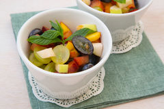 Fruit salad in white dishes Royalty Free Stock Images