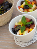 Fruit salad in white dishes Stock Image