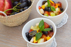 Fruit salad in white dishes Royalty Free Stock Photos