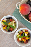 Fruit salad in white dishes Stock Photo