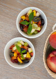 Fruit salad in white dishes Stock Photos