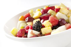 Fruit salad in white plate Stock Photos