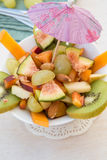 Fruit salad in the white plate Stock Photos