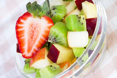 Fruit salad in white plate on tablecloth Royalty Free Stock Photography