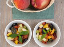 Fruit salad in the white plates Stock Images