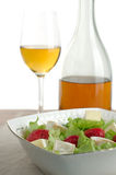 Fruit salad and white wine. Excellent white wine and fruit salad with cheese Royalty Free Stock Photos