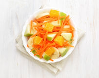 Fruit salad on white wooden table, top view Royalty Free Stock Photos