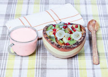 Fruit salad in a wooden bowl, yogurt. stock image