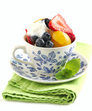 Fruit salad with yogurt in cup Royalty Free Stock Photos