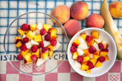 Fruit salads. On a kitchen towel Stock Photos