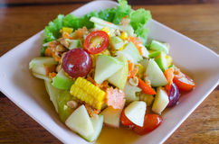 Fruit salads. Thailand style fruit salads, mixed fresh fruit with sauce tastes sour, salty, sweet royalty free stock image