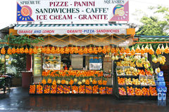 Fruit and Sandwich Stand, Southern Italy. An outdoor stand in southern Italy selling oranges, lemons, sandwiches and other food royalty free stock photo