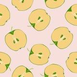 Fruit sans couture de pomme coupé en tranches dans la moitié Image libre de droits