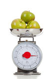 Fruit on a scale with a white background royalty free stock photo