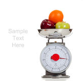 Fruit on a scale with a white background Stock Images