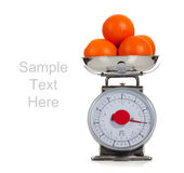 Fruit on a scale with a white background Stock Photos