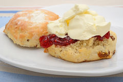 Fruit scone on plate stock images