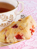Fruit Scone with Tea. Cranberry cherry scone with a tea cup and saucer Stock Photography