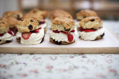 Fruit scones. With raspberries and cream for sale in a Bakery Royalty Free Stock Images