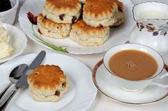 Fruit scones with tea. royalty free stock images
