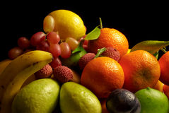 Fruit Selection. Selection of fresh fruit against a black background royalty free stock image
