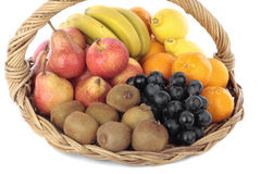 Fruit selection on basket Stock Images