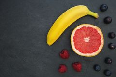 Fruit selection on dark food background copy space stock photos