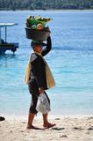 Fruit seller on a beach. Woman selling fruits on a beach on one of the Gili Islands, Indonesia stock photography