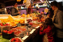 Fruit seller and customer at Market ,Barcelona Stock Image