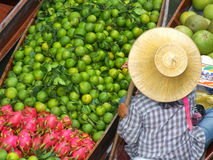 Fruit seller at Floating Bazaar in Thailand Royalty Free Stock Photography