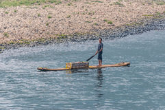 Fruit seller on his raft Stock Photography