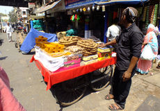 Fruit seller in Mumbai. Man selling dried fruits in the streets of Mumbai, near Mohamedali Road Stock Photo