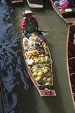 Fruit seller paddling a boat Thailand Royalty Free Stock Image