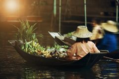Fruit seller sailing boat in dumneon saduak floating market ratchaburi thailand stock photography
