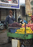 Fruit seller selling fruits on the roadside vehicle shop on rainy day in Ooty Royalty Free Stock Photo