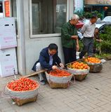 Fruit sellers. Preparing yoke and buckets near chongqing market stock photos