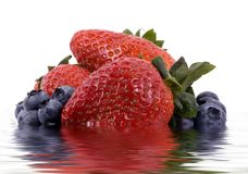 Fruit Series (Isolated blueberries and strawberries in water) Royalty Free Stock Photos