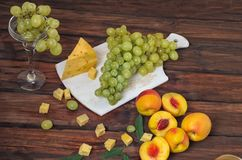 Fruit set with cheese and grapes. Nectarines Stock Photos