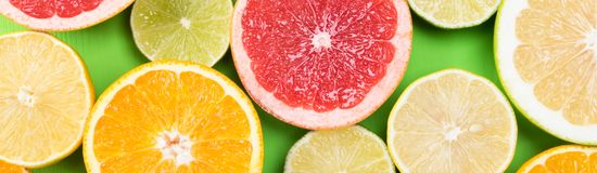Fruit set of citrus on a green background Royalty Free Stock Images