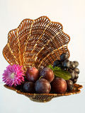 Fruit set. Selection of fresh fruit lie on the wicker cradle isolated on a light background Royalty Free Stock Images