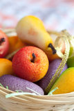 Fruit shaped candies in macro image of marzipan sweets in a bask Royalty Free Stock Images