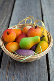 Fruit shaped candies in macro image of marzipan sweets in a bask Stock Images