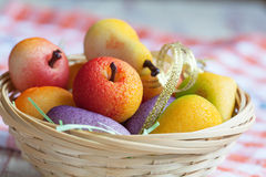 Fruit shaped candies in macro image of marzipan sweets in a bask Royalty Free Stock Image