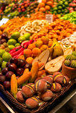Fruit shaped marzipan confectioneries at the boqueria market in Stock Image