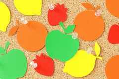 Fruit shaped paper note on pinboard. Fruit shaped paper note on cork pinboard Royalty Free Stock Photography