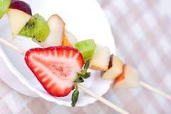 Fruit shashlik on white plate Stock Photography
