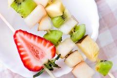 Fruit shashlik on white plate Royalty Free Stock Image