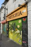 Fruit shop with vibrant and colourful graffiti on entrance stock image