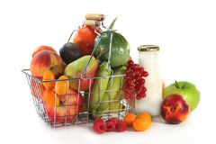 Fruit shopping. A shopping basket filled with fresh fruit Royalty Free Stock Image