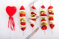 Fruit skewer. Fruit on a stick to a healthy diet Royalty Free Stock Image